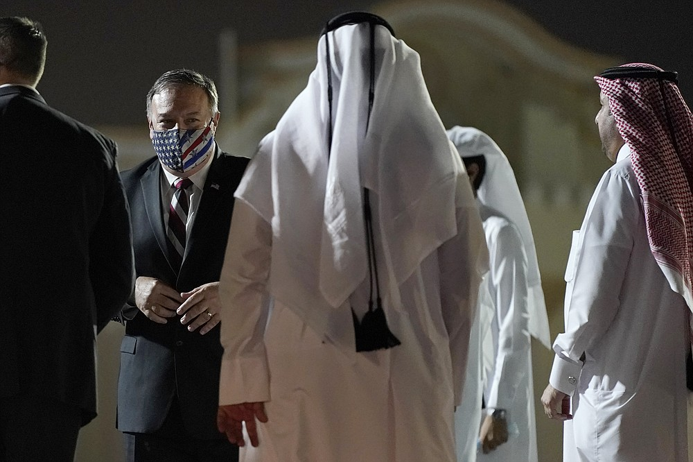 Secretary of State Mike Pompeo prepares to board a plane at Old Doha International Airport, Saturday, Nov. 21, 2020, in Doha, Qatar. Pompeo is en route to the United Arab Emirates. (AP Photo/Patrick Semansky, Pool)