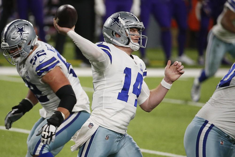 Dallas Cowboys quarterback Andy Dalton throws a pass during the second half of an NFL football game against the Minnesota Vikings, Sunday, Nov. 22, 2020, in Minneapolis. The Cowboys won 31-28. (AP Photo/Bruce Kluckhohn)