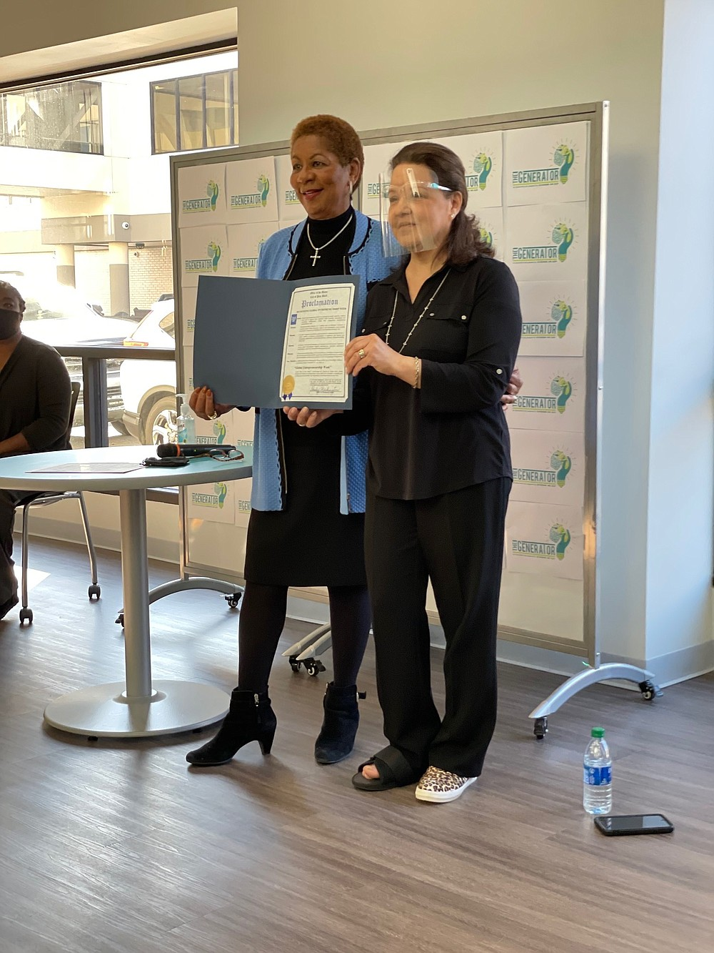 Mayor Shirley Washington, left, stopped by during Global Entrepreneurship activities at The Generator during the week and read a proclamation taking note of the week and the work that The Generator is doing. Mildred Franco, director of The Generator, is shown holding the proclamation. (Submitted photo)