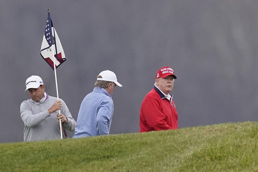 President Donald Trump plays golf at Trump National Golf Club, Friday, Nov. 27, 2020, in Sterling, Va. (AP Photo/Alex Brandon)