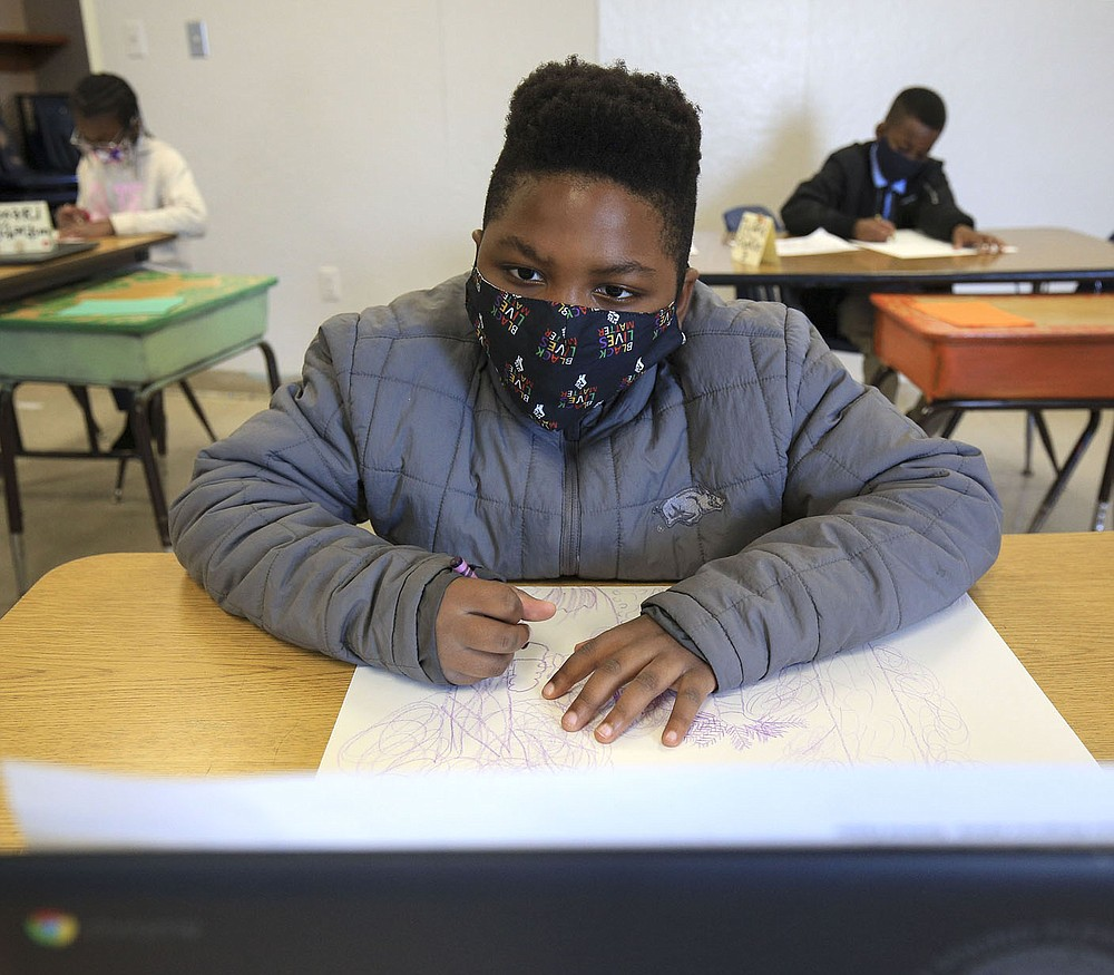 Jeremy Williams, 9, works Nov. 18 on an art project during Stephanie Crowell's fourth-grade art class at Carver Magnet Elementary School in Little Rock. Check out nwaonline.com/201129Daily/ for today's photo gallery. (Arkansas Democrat-Gazette/Staton Breidenthal)