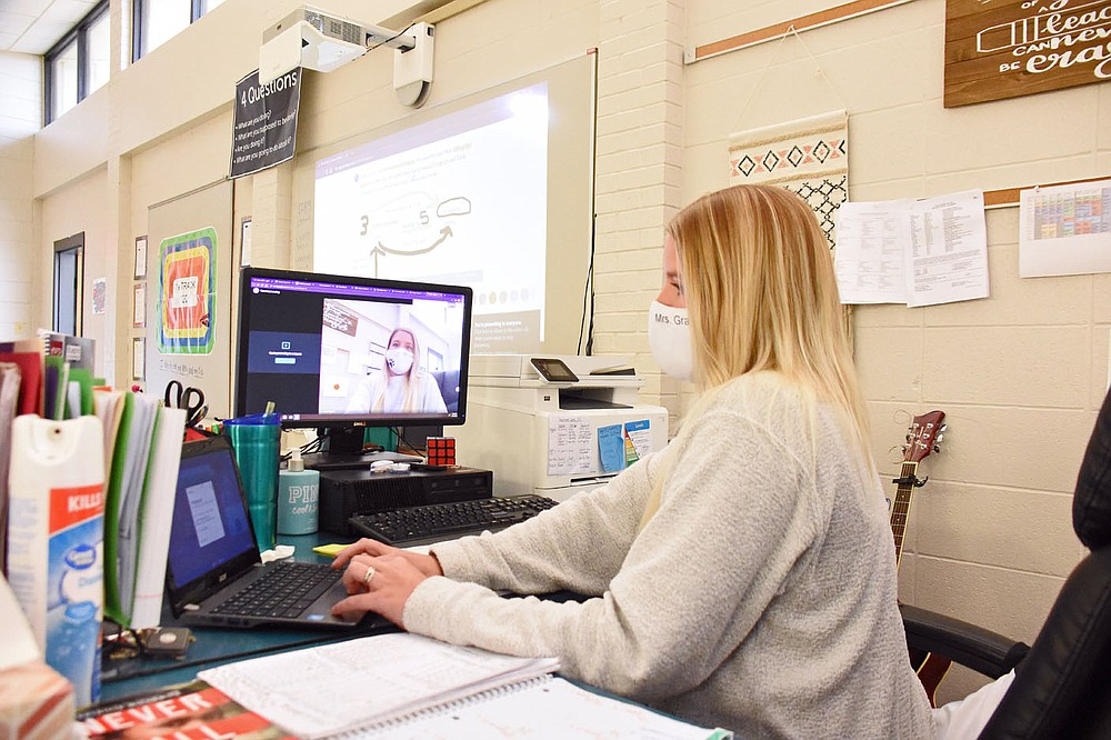 Amber Graham, a K-12 special education teacher, demonstrates Nov. 11 how multiple screens are used to teach virtually and traditionally at Searcy Learning Center. (Arkansas Democrat-Gazette/Staci Vandagriff)
