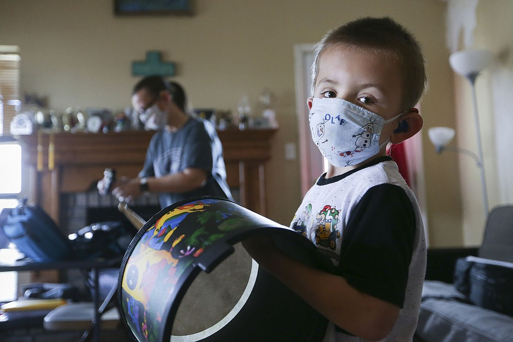Colton Andrews, 6, works on school work Nov. 20 at their home in Greenwood. Greenwood shifted to all-virtual instruction for the latter part of November including Colton and Christina. Colton is a special-education student with a learning disability and Christina has ADHD. Check out nwaonline.com/201129Daily/ for today's photo gallery.  (NWA Democrat-Gazette/Charlie Kaijo)