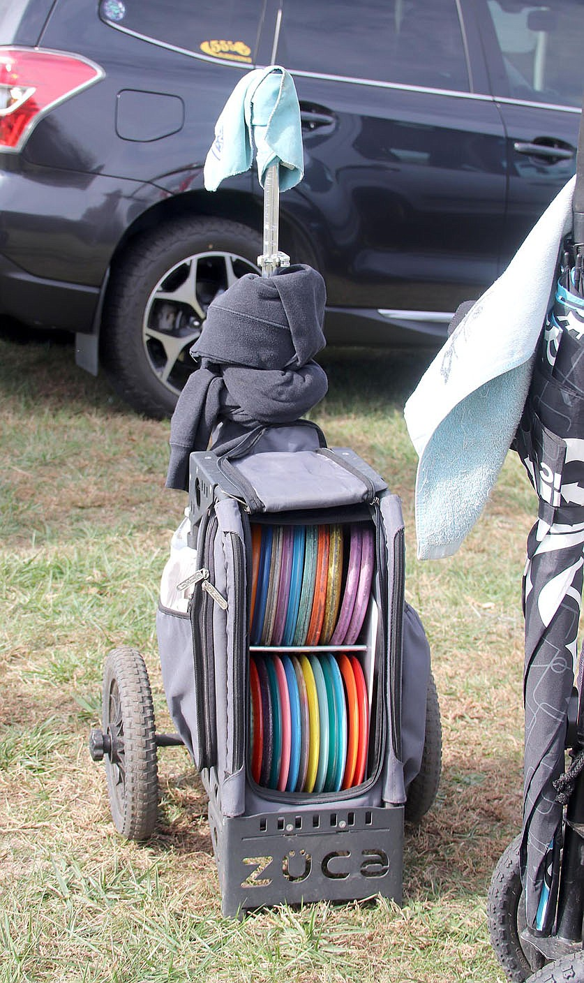 LYNN KUTTER ENTERPRISE-LEADER One of the disc golf bags for a player competing in a tournament in November that was spread out over three courses, including Farmington's 18-hole disc golf course at Creekside Park.