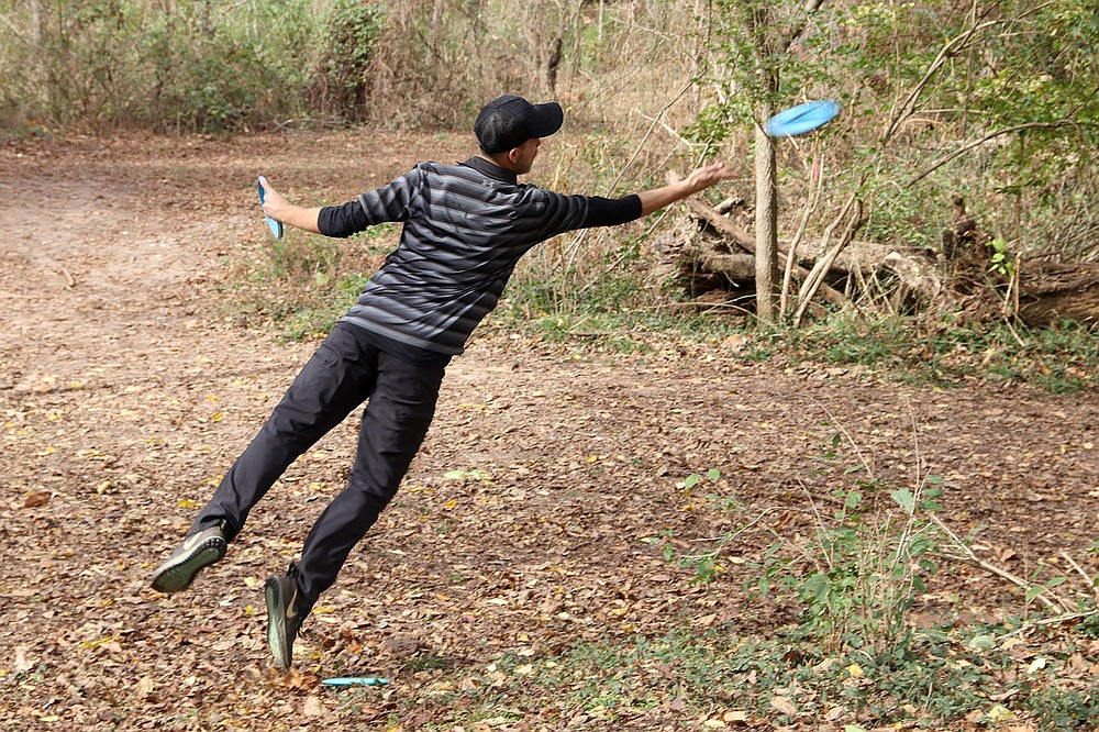 LYNN KUTTER ENTERPRISE-LEADER  Steve Gerg of Texarkana launches a disc toward the basket during a recent tournament at Creekside Park. About 272 players competed in the three-day tournament, including men's and women's professional players.