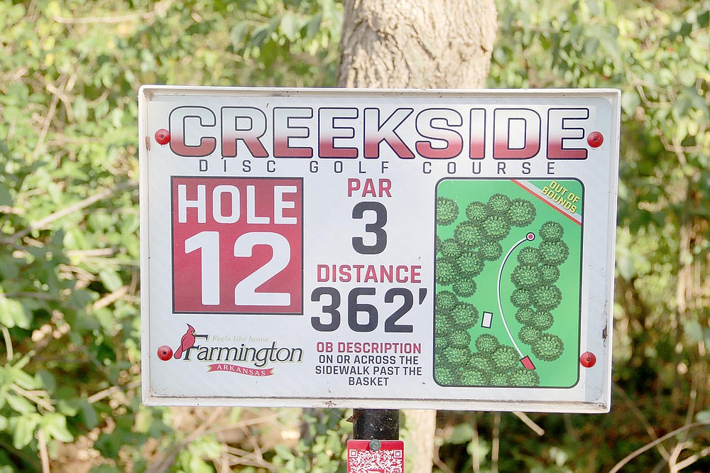 LYNN KUTTER ENTERPRISE-LEADER Each hole at the 18-hole disc golf course at Creekside Park in Farmington has this type sign for players.