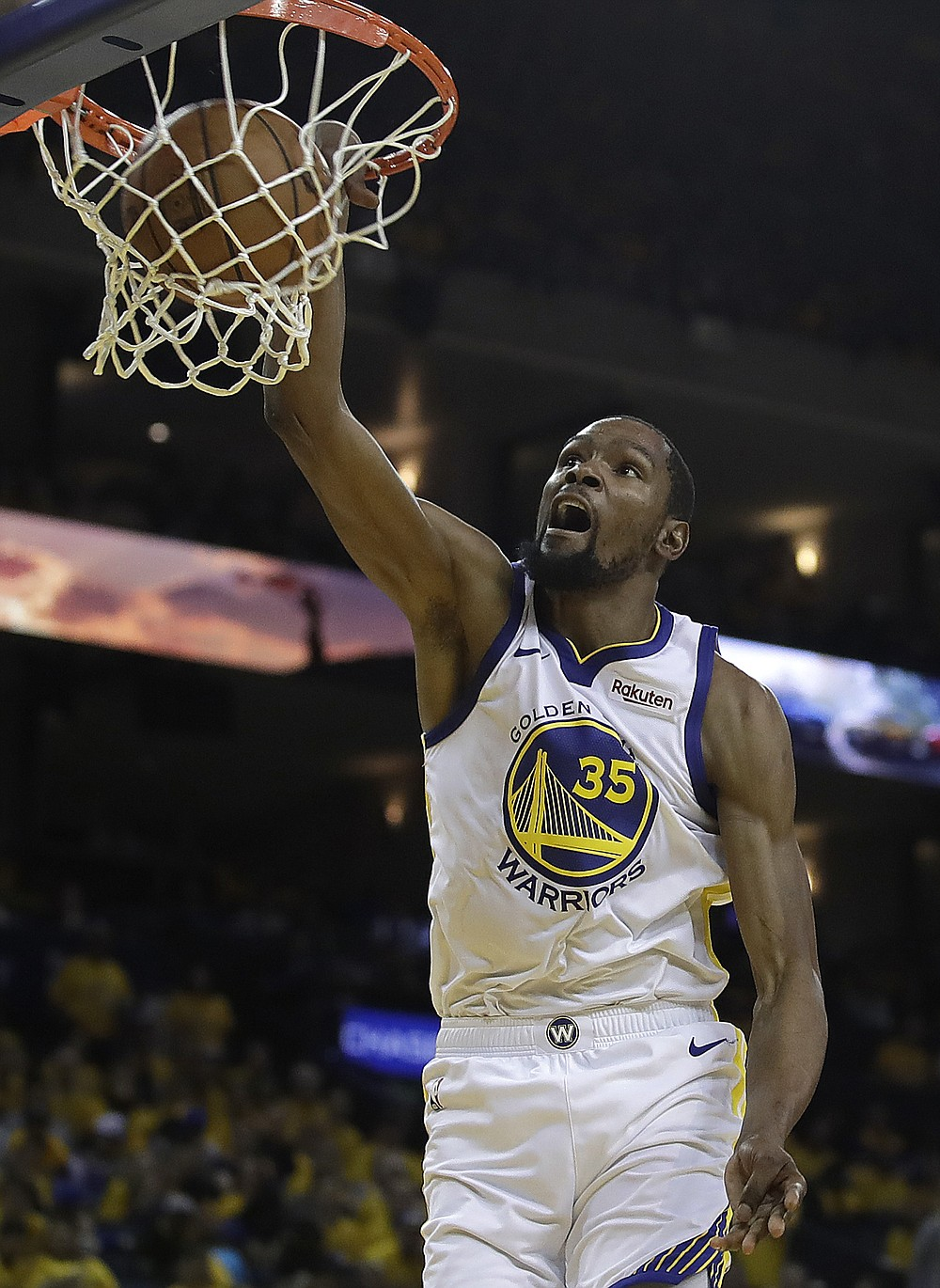 FILE - In this April 13, 2019, file photo, then-Golden State Warriors' Kevin Durant scores against the Los Angeles Clippers in the second half in Game 1 of a first-round NBA basketball playoff series in Oakland, Calif. Kevin Durant is finally within weeks of suiting up for the Brooklyn Nets. Sidelined last season while recovering from surgery on his Achilles tendon, he begins training camp this week on a team that can contend for the NBA title if he can be as good as he was before his injury. (AP Photo/Ben Margot, File)