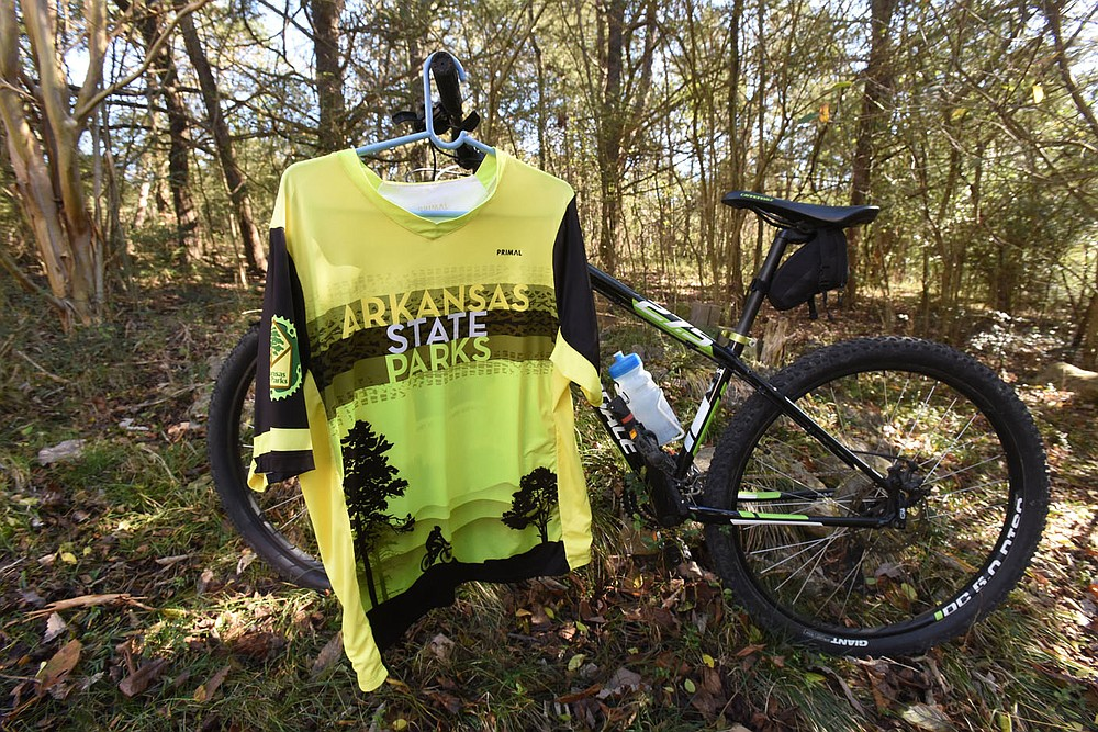 An Arkansas State Parks cycling jersey is sure to please the pedalers on your gift list. They're available at Arkansas State Parks visitor centers. Throwing in a new mountain bike with the jersey is optional. (NWA Democrat-Gazette/Flip Putthoff)
