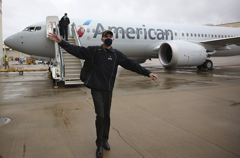 American Airlines Boeing 737 Max takes off at Tulsa International Airport to fly to Dallas, Wednesday, December 2, 2020 in Tulsa, Okla .. Earlier, the plane had flown a group of journalists and American Airlines employees from Dallas to American Airlines Tulsa maintenance facility.  (Mike Simons / Tulsa World via AP)