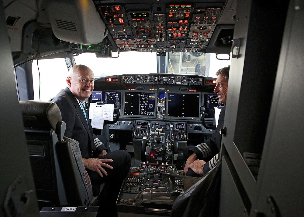 Pilots Peter Gamble, left, and John Konstanzer talk to reporters and crew members after flying a Boeing 737 Max from Dallas and arriving at American Airlines Tulsa maintenance facility on Wednesday, December 2, 2020 in Tulsa, Okla. Earlier, the plane had flown a group of journalists and American Airlines employees from Dallas to American Airlines Tulsa maintenance facility.  (Mike Simons / Tulsa World via AP)