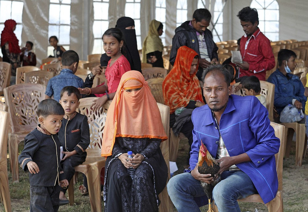 Rohingya refugees wait to be transported on a naval vessel to Bhashan Char, or floating island, in the Bay of Bengal, from Chittagong, Bangladesh, Friday, Dec. 4, 2020. Authorities in Bangladesh on Friday started sending a first group of nearly more than 1,500 Rohingya refugees to an isolated island despite calls by human rights groups for a halt to the process. (AP Photo).
