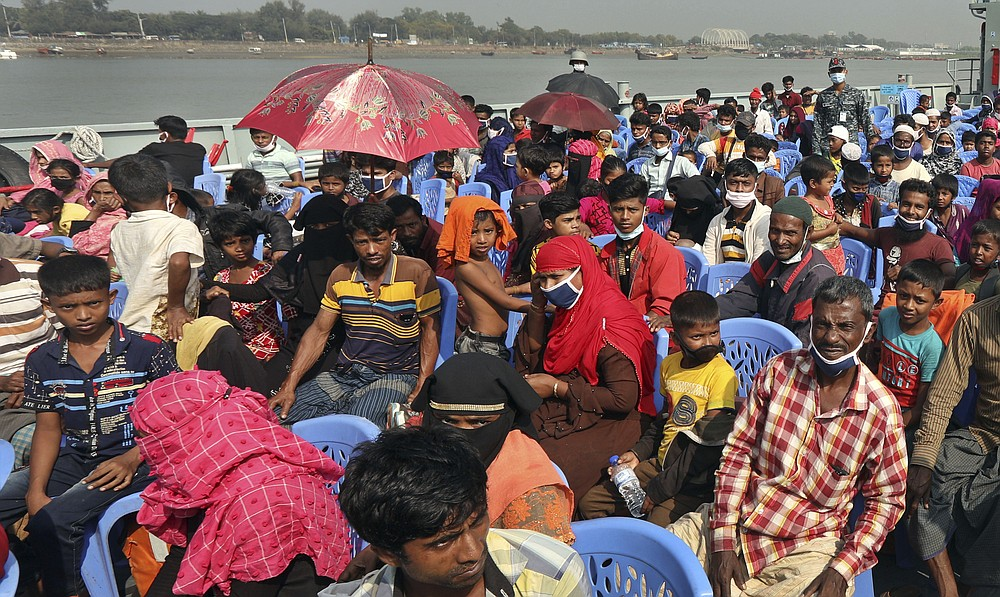 Rohingya refugees are transported on a naval vessel to Bhashan Char, or floating island, in the Bay of Bengal, from Chittagong, Bangladesh, Friday, Dec. 4, 2020. Authorities in Bangladesh on Friday started sending a first group of nearly more than 1,500 Rohingya refugees to an isolated island despite calls by human rights groups for a halt to the process. (AP Photo).