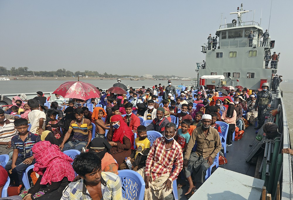 Rohingya refugees are transported on a naval vessel to Bhashan Char, or floating island, in the Bay of Bengal, from Chittagong, Bangladesh, Friday, Dec. 4, 2020. Authorities in Bangladesh on Friday started sending a first group of nearly more than 1,500 Rohingya refugees to an isolated island despite calls by human rights groups for a halt to the process. (AP Photo)