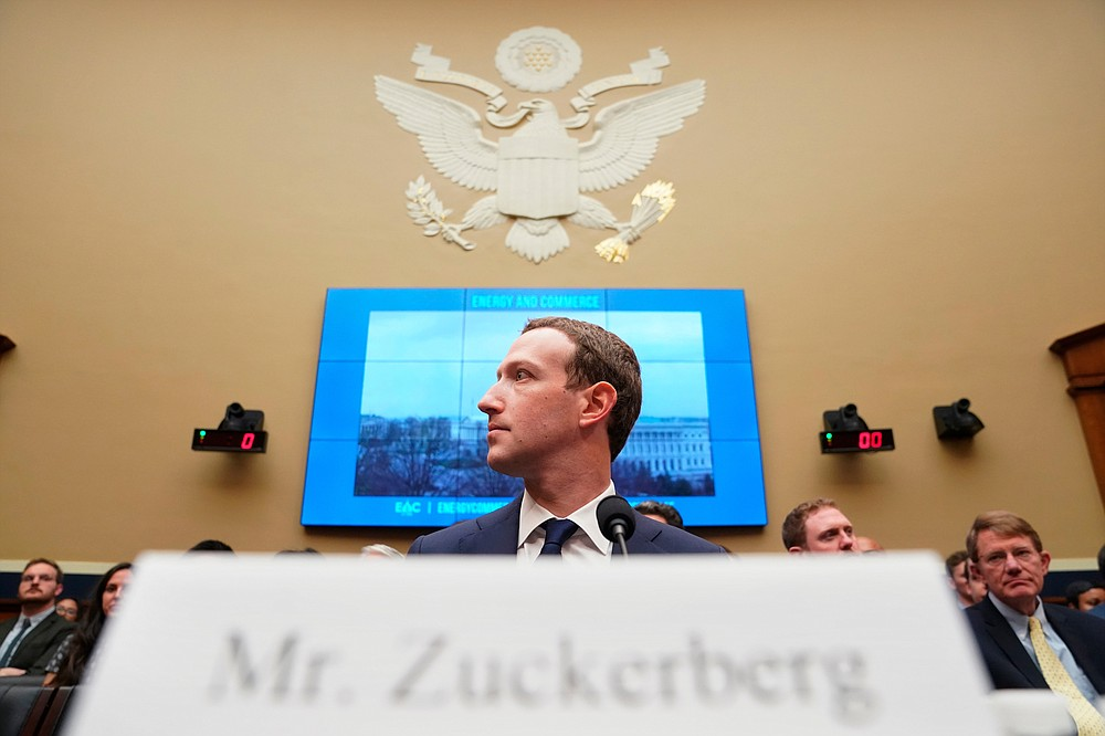 FILE - In this April 11, 2018, file photo, Facebook CEO Mark Zuckerberg testifies before a House Energy and Commerce hearing on Capitol Hill in Washington, about the use of Facebook data to target American voters in the 2016 election and data privacy. Federal regulators asked Wednesday, Dec. 9, 2020, for Facebook to be ordered to divest its Instagram and WhatsApp messaging services as the U.S. government and 48 states and districts accused the company of abusing its market power in social networking to crush smaller competitors. The antitrust lawsuits were announced by the Federal Trade Commission and New York Attorney General Letitia James. (AP Photo/Andrew Harnik, File)