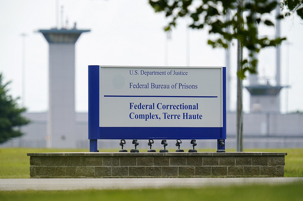 FILE - This Aug. 28, 2020, file photo shows the federal prison complex in Terre Haute, Ind.  (AP Photo/Michael Conroy, File)
