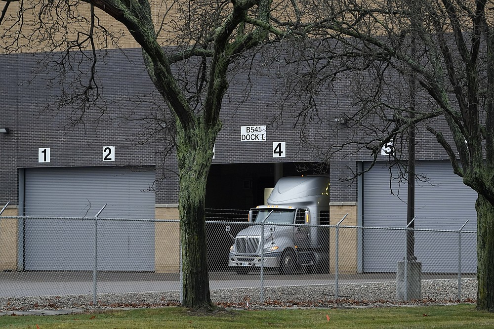 A truck is shown at the Pfizer Global Supply Kalamazoo manufacturing plant in Portage, Mich., Saturday, Dec. 12, 2020. (AP Photo/Paul Sancya)
