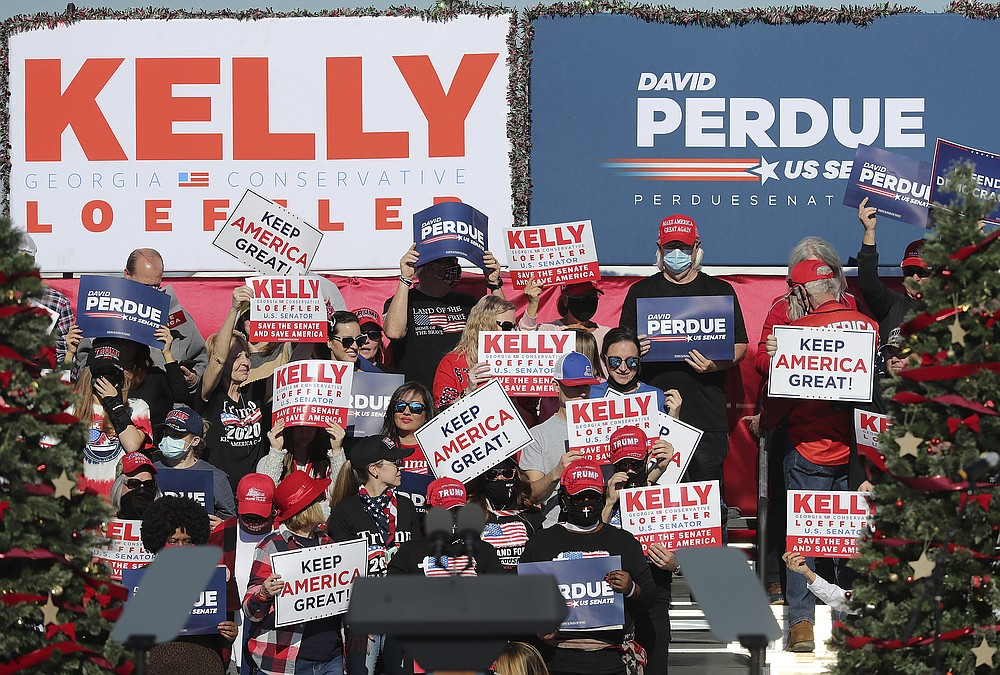 Supporters of Sens. Kelly Loeffler, R-Ga., and David Perdue, R-Ga., wait for the arrival of Vice President Mike Pence at his Defend the Majority Rally on Thursday, Dec. 10, 2020, in Augusta, Ga. (Curtis Compton/Atlanta Journal-Constitution via AP)