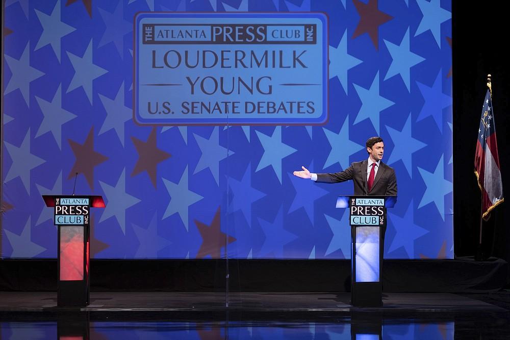 Democratic challenger Jon Ossoff speaks during a debate for U.S. Senate on Sunday, Dec. 6, 2020, in Atlanta. Sen. David Perdue declined to attend the debate. (AP Photo/Ben Gray, Pool)