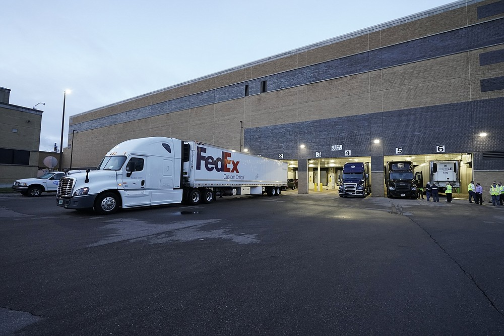 A truck loaded with the Pfizer-BioNTech COVID-19 vaccine leaves the Pfizer Global Supply Kalamazoo manufacturing plant in Portage, Mich., Sunday, Dec. 13, 2020. (AP Photo/Morry Gash, Pool)