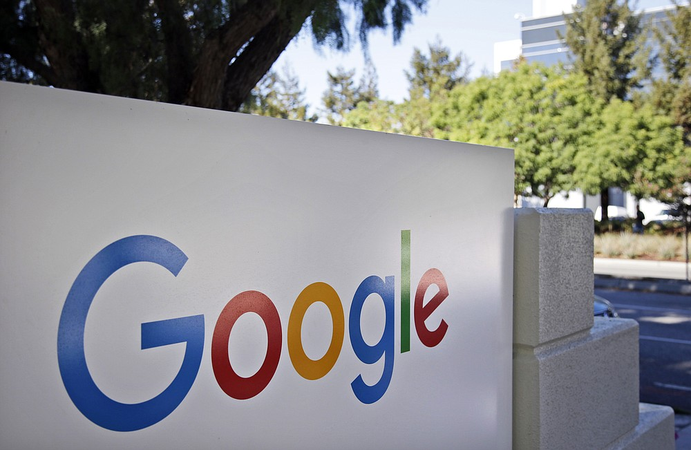 This Oct. 20, 2015, file photo, shows signage outside Google headquarters in Mountain View, Calif. A group of 35 states as well as the District of Columbia and the territories of Guam and Puerto Rico filed an anti-trust lawsuit against Google on Thursday, Dec. 17, 2020, alleging that the search giant has an illegal monopoly over the online search market that hurts consumers and advertisers. The lawsuit, announced by Colorado Attorney General Phil Weiser, was filed in federal court in Washington, D.C. by states represented by bipartisan attorneys general. (AP Photo/Marcio Jose Sanchez, File)