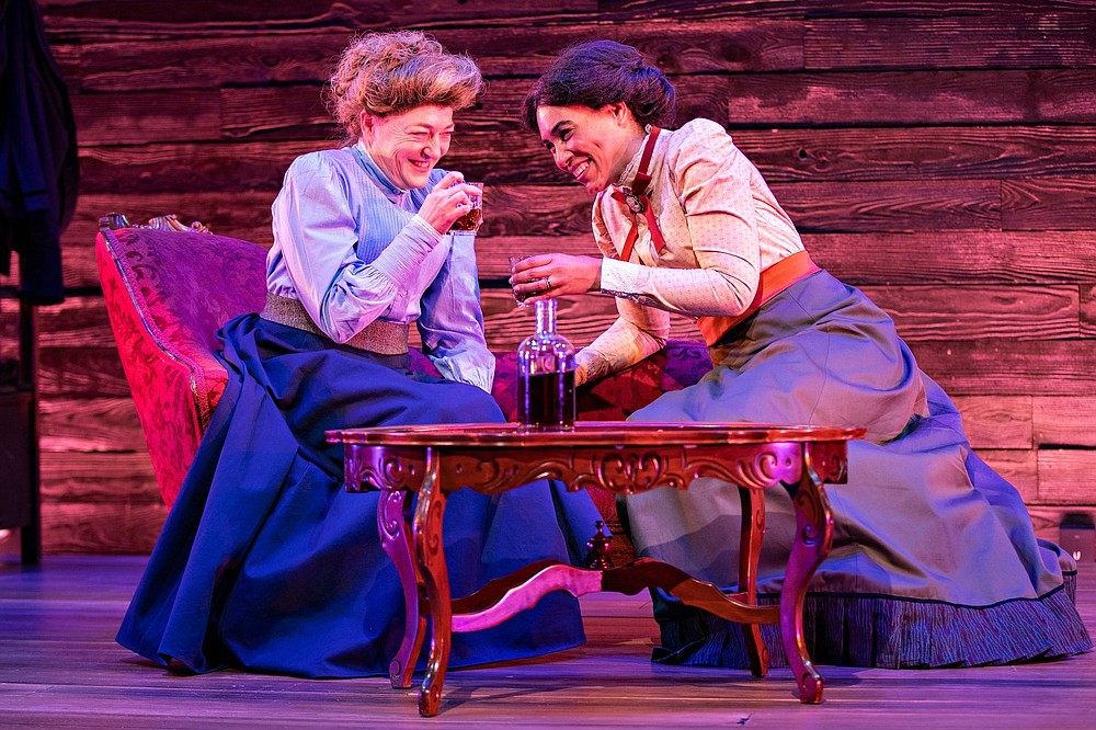 """Rebecca Harris (left) plays Marie Curie, with Leontyne Mbele-Mbong as her close friend Hertha Ayrton in """"The Half Life off Marie Curie,"""" streaming through Jan. 17 from Fayetteville-based TheatreSquared. (Special to the Democrat-Gazette/Wesley Hitt)"""