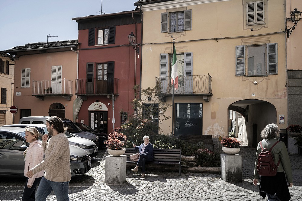 """A street scene in Torre Pellice, which includes a neighborhood known as the """"Waldensian Quarter,"""" in Italy, Sept. 28, 2020. Mindful of a history of persecution, members of the Waldensians have been at the forefront of a push to bring refugees from Syria to Italy. (Alessandro Grassani/The New York Times)"""