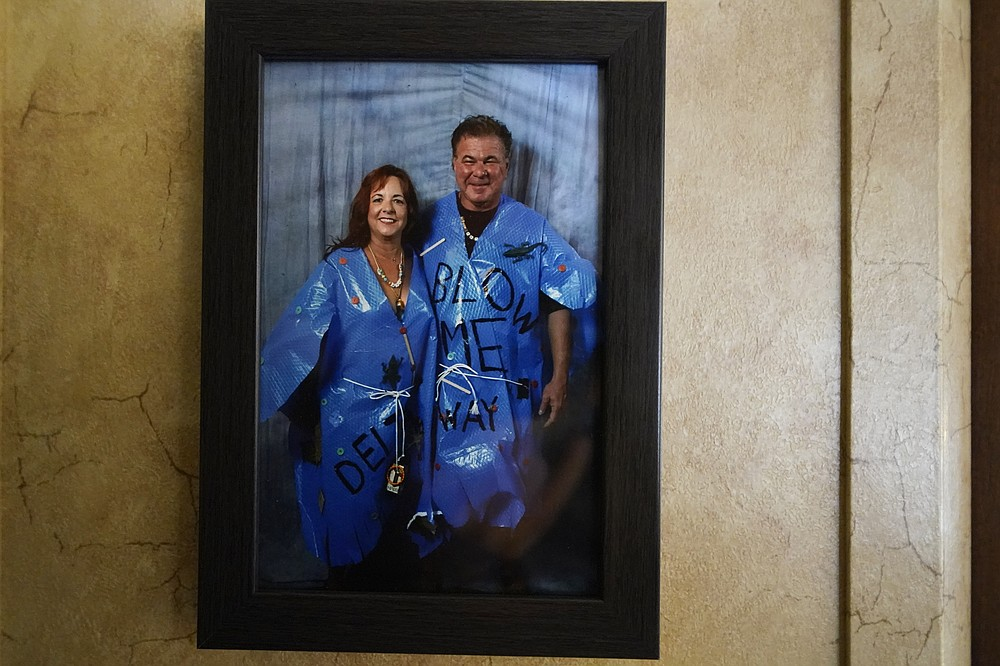 A framed photo of Dewana Young and her husband Pete is seen, as they are dressed in Halloween costumes, as hurricanes Laura and Delta, in the aftermath of the two storms, in Grand Lake, La., Friday, Dec. 4, 2020. (AP Photo/Gerald Herbert)