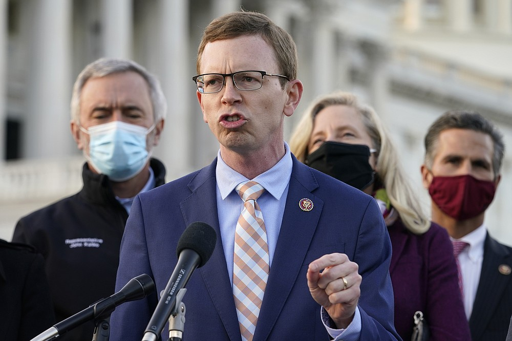 Rep. Dusty Johnson, R-S.D., speaks during a news conference with the Problem Solvers Caucus about the expected passage of the emergency COVID-19 relief bill, Monday, Dec. 21, 2020, on Capitol Hill in Washington. Congressional leaders have hashed out a massive, year-end catchall bill that combines $900 billion in COVID-19 aid with a $1.4 trillion spending bill and reams of other unfinished legislation on taxes, energy, education and health care. (AP Photo/Jacquelyn Martin)