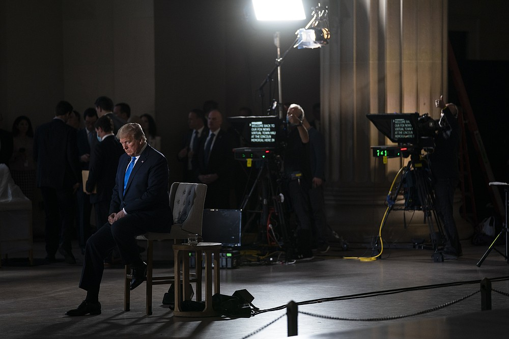 FILE - In this May 3, 2020, file photo President Donald Trump waits for a segment to start during a Fox News virtual town hall from the Lincoln Memorial in Washington. The most improbable of presidents, Donald Trump reshaped the office and shattered its centuries-old norms and traditions while dominating the national discourse like no one before. (AP Photo/Evan Vucci, File)
