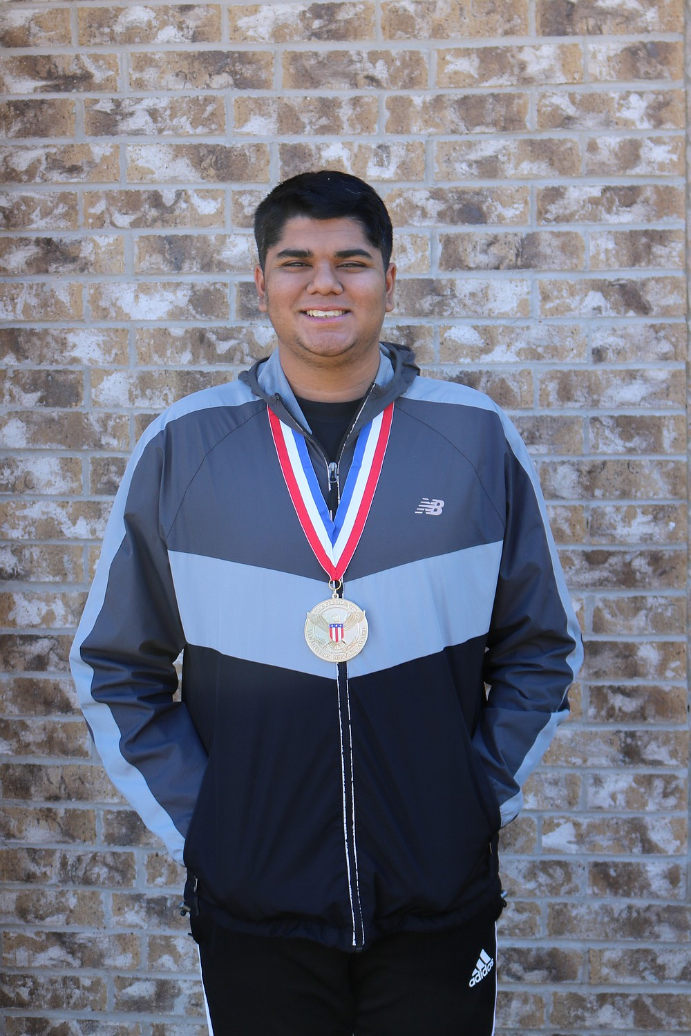Dylan Patel — shown here with his Presidential Volunteer Service Award — has served as a volunteer counselor for Camp Aldersgate, as a volunteer at the information center at St. Vincent's Infirmary and as a member of the North Little Rock Mayor's Youth Council. These days, he's busy helping other students struggling with virtual school tackle difficult math problems.