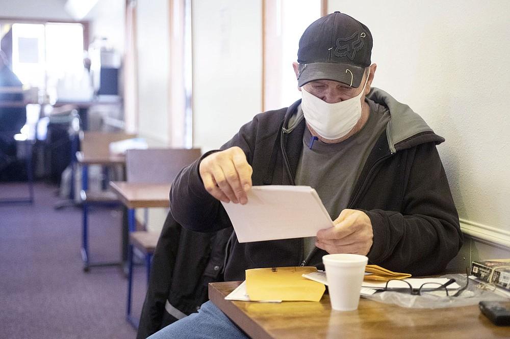 Richard Graham sits Tuesday at the 7 Hills day center operation. (NWA Democrat-Gazette/J.T. Wampler)