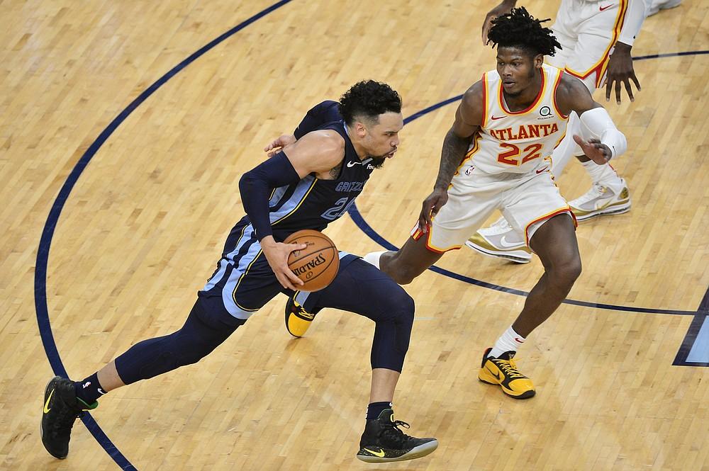 Memphis Grizzlies guard Dillon Brooks, left, drives against Atlanta Hawks forward Cam Reddish, right, in the first half of an NBA basketball game Saturday, Dec. 26, 2020, in Memphis, Tenn. (AP Photo/Brandon Dill)