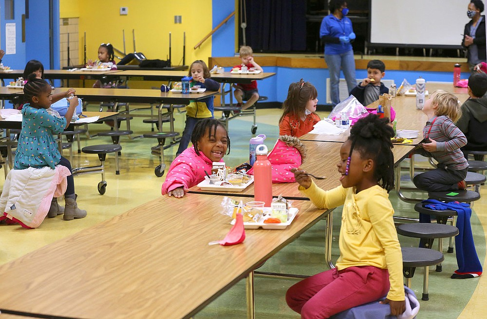 Kindergarten students eat their lunch Dec. 11 while socially distanced in the lunchroom at Gibbs Magnet Elementary School in Little Rock.  Check out nwaonline.com/201228Daily/ and nwadg.com/photos for a photo gallery. (Arkansas Democrat-Gazette/Thomas Metthe)