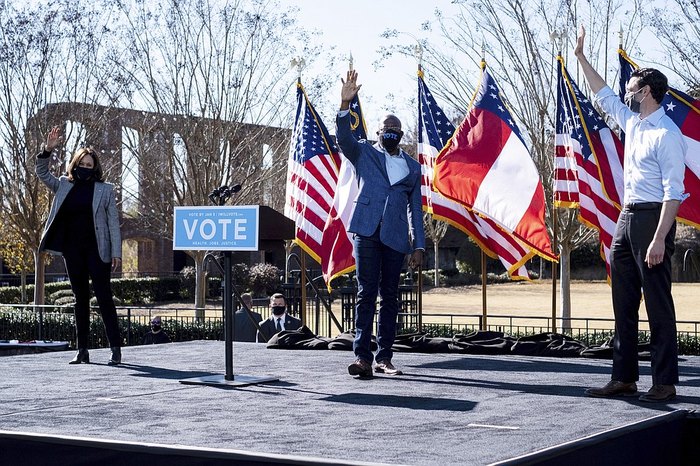 Vice President-Elect Kamala Harris, left, campaigns for Democratic U.S. Senate challengers the Rev. Raphael Warnock and Jon Ossoff, Monday, Dec. 21, 2020, in Columbus, Ga. (AP Photo/Ben Gray)