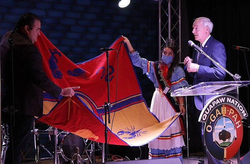In October, Quapaw Chairman Joseph Tali Byrd (left) and Tribal Princess Kristal Glass presented Gov. Asa Hutchinson with a tribal blanket, which Byrd said is one of the highest honors the Quapaw Nation can bestow. The presentation was made at a sneak preview of the Saracen Casino Resort as it prepared for a grand opening. (Pine Bluff Commercial/Dale Ellis)