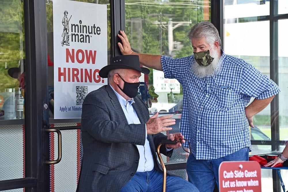 Jacksonville Mayor Bob Johnson (left) chatted with Jacksonvillian Jerry Saunders at the Minute Man grand opening. (Democrat-Gazette file photo/Staci Vandagriff)