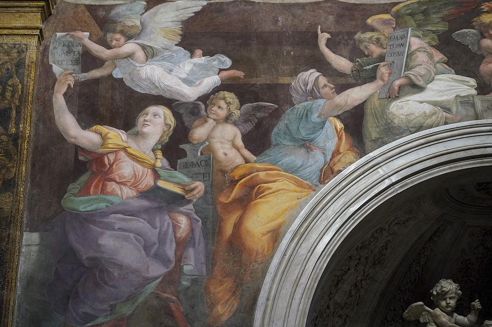 """A detail of the 1514 fresco """"Sybils Receiving Instruction From Angels"""" by Italian High Renaissance master painter Raffaello Sanzio, known as Raphael, adorns the inside of Santa Maria della Pace church in Rome. Elsewhere in Europe, art lovers have been relying on virtual tours during the covid-19 pandemic to view works of art held by famous institutions such as the Uffizi in Florence and the Vatican Museums in Rome. (AP/Andrew Medichini)"""
