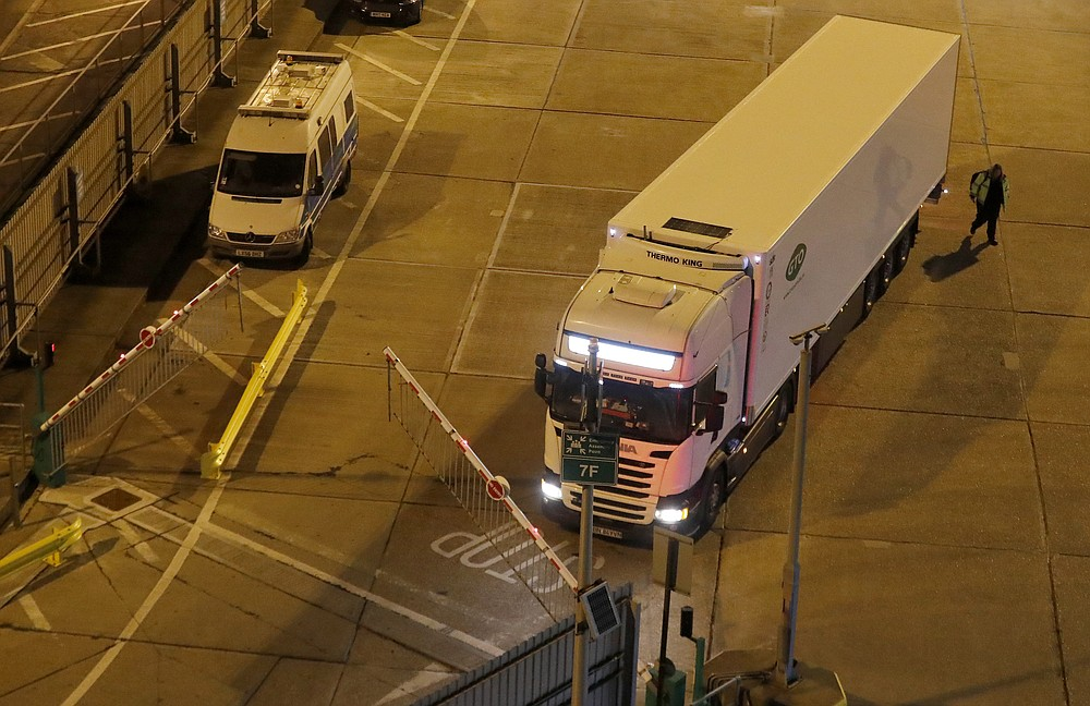 A lorry passes a barrier after disembarking the first ferry that arrived after the end of the transition period with the EU at the port in Dover, Friday, Jan. 1, 2021. Britain left the European bloc's vast single market for people, goods and services at 11 p.m. London time, midnight in Brussels, completing the biggest single economic change the country has experienced since World War II.(AP Photo/Frank Augstein)
