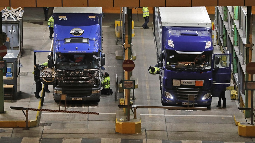 Lorries that arrived after the end of the transition period with the European Union are checked at the port in Dover, England, Thursday, Dec. 31, 2020. Britain left the European bloc's vast single market for people, goods and services at 11 p.m. London time, midnight in Brussels, completing the biggest single economic change the country has experienced since World War II. (AP Photo/Frank Augstein)