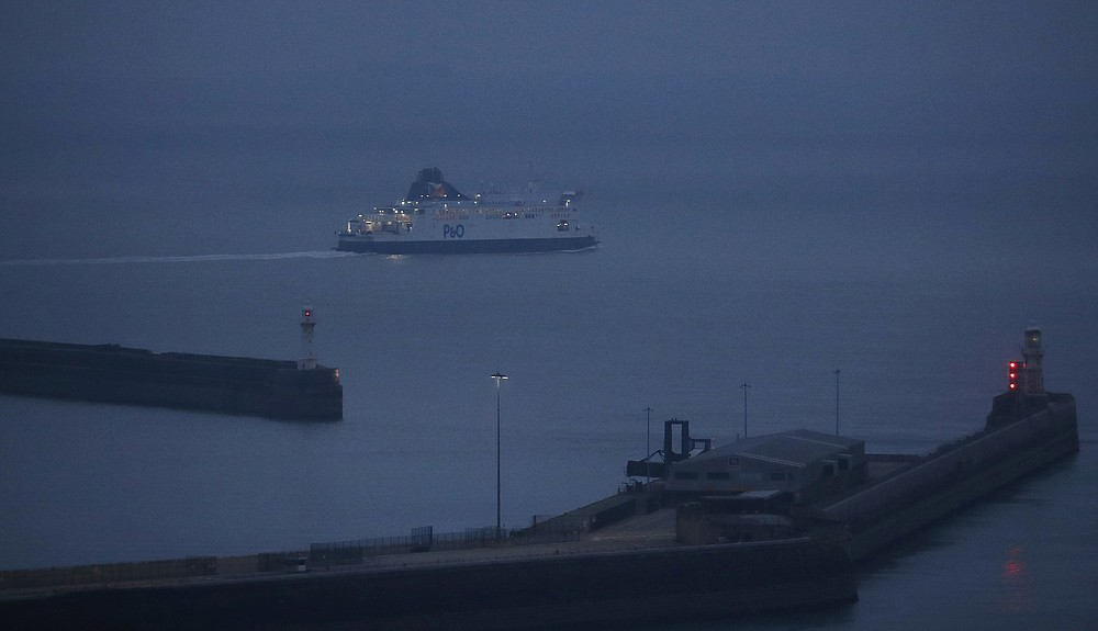 The first ferry leaves after the end of the transition period with the EU at the port in Dover, Friday, Jan. 1, 2021. Britain left the European bloc's vast single market for people, goods and services at 11 p.m. London time, midnight in Brussels, completing the biggest single economic change the country has experienced since World War II. (AP Photo/Frank Augstein)