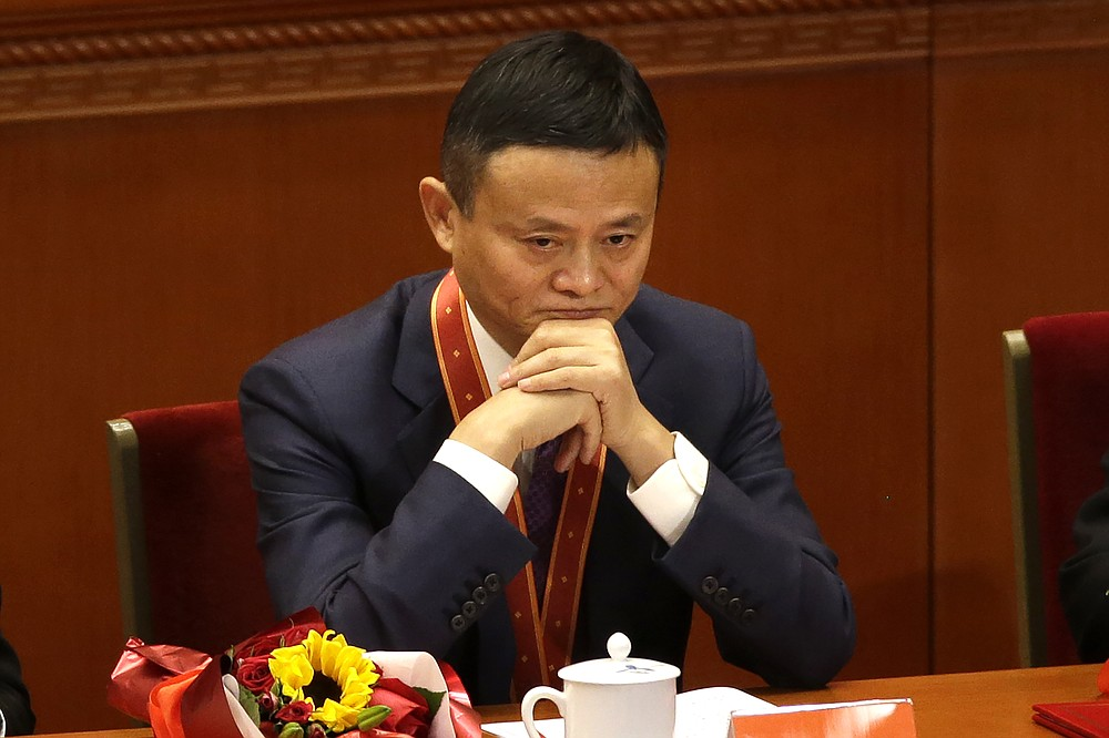 Jack Ma, founder of Chinese e-commerce firm Alibaba Group, attends a conference to commemorate the 40th anniversary of China's Reform and Opening Up policy at the Great Hall of the People in Beijing, Tuesday, Dec. 18, 2018. Ma hasn't been seen since he angered regulators with an October 2020 speech. That is prompting speculation about what might happen to the billionaire founder of the world's biggest e-commerce company. (AP Photo/Mark Schiefelbein)
