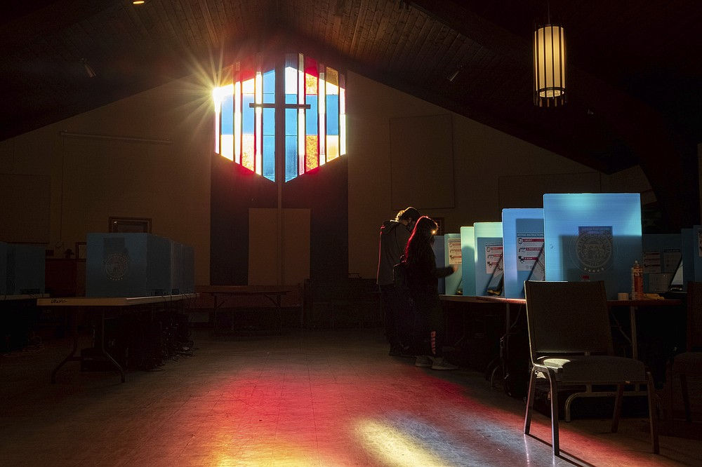 Voters mark their ballots at the Lawrenceville Road United Methodist Church in Tucker, Ga. during the Senate runoff election Tuesday morning, Jan. 5, 2021. (AP Photo/Ben Gray)