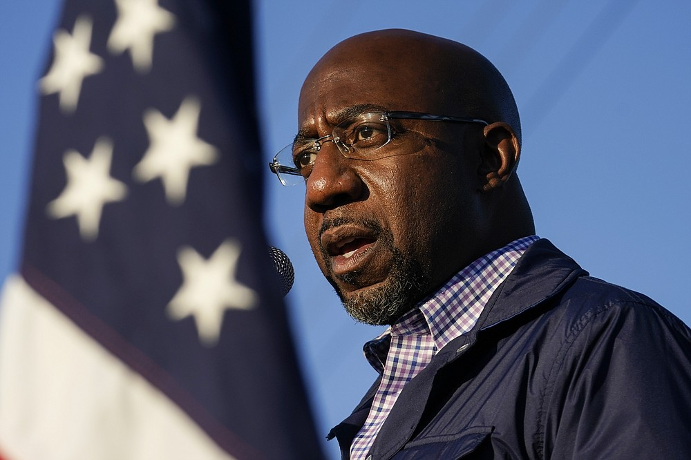 FILE - In this Nov. 15, 2020, file photo Raphael Warnock, a Democratic candidate for the U.S. Senate, speaks during a campaign rally in Marietta, Ga. As the head of the Atlanta church where Martin Luther King Jr. preached, Warnock has not shied away from impassioned sermons and forceful advocacy on behalf of the poor and disadvantaged. The 51-year-old now wants to take that progressive platform to the U.S. Senate. He is running to unseat one of Georgia's Republican senators, Kelly Loeffler, in the Jan. 5 race.  (AP Photo/Brynn Anderson, File)