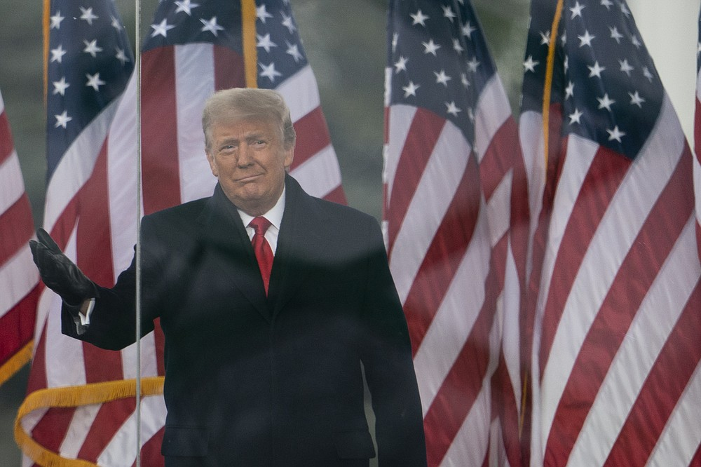 President Donald Trump arrives to speak at a rally protesting the electoral college certification of Joe Biden as President, Wednesday, Jan. 6, 2021, in Washington. (AP Photo/Evan Vucci)