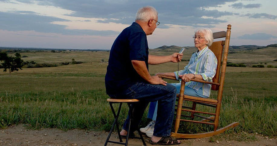 "Over 14 years, Jim Puppe traveled across North Dakota, collecting tales from residents of every town, which led to his book ""Dakota Attitude."" Above, he interviewed Pauline Koch Roll, from tiny Heil, who gave birth to 21 children in 21 years, the last in 1971. For Pauline, big families are a blessing. ""Well, see, I come from a big family , so it really didn't bother me that it's too much work.""  (Courtesy Photo/Jesse Knutson)"