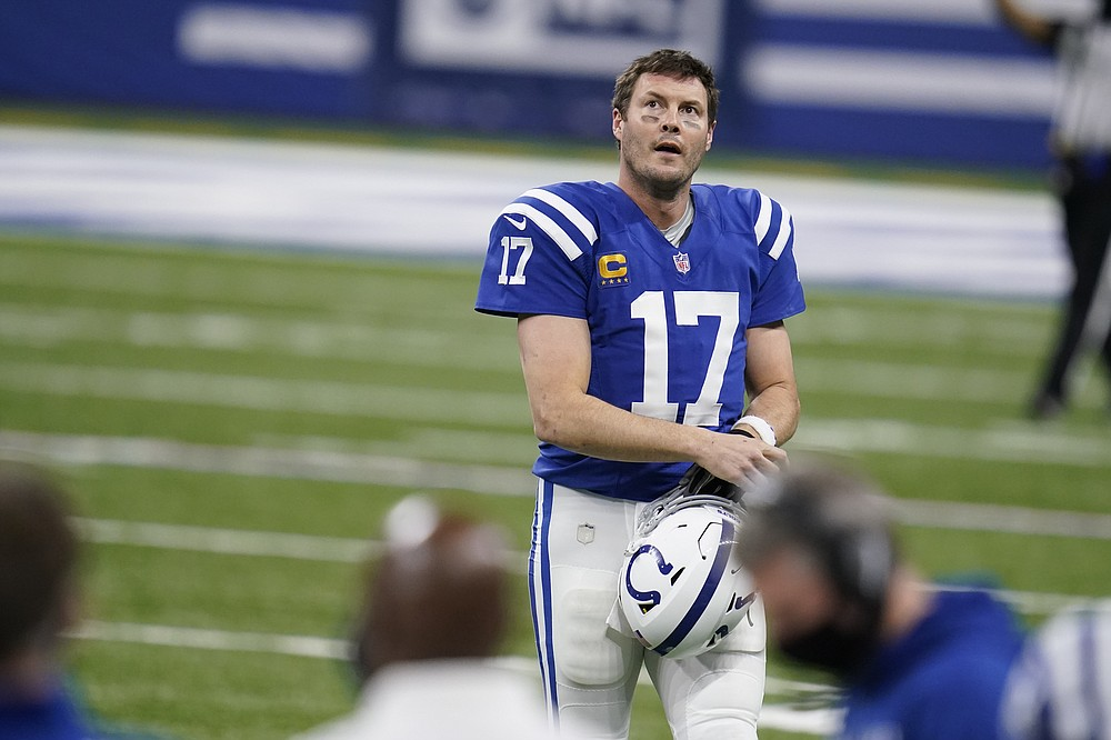 Indianapolis Colts quarterback Philip Rivers (17) walks off the field after throwing an interception during the second half of an NFL football game against the Jacksonville Jaguars, Sunday, Jan. 3, 2021, in Indianapolis. (AP Photo/Michael Conroy)