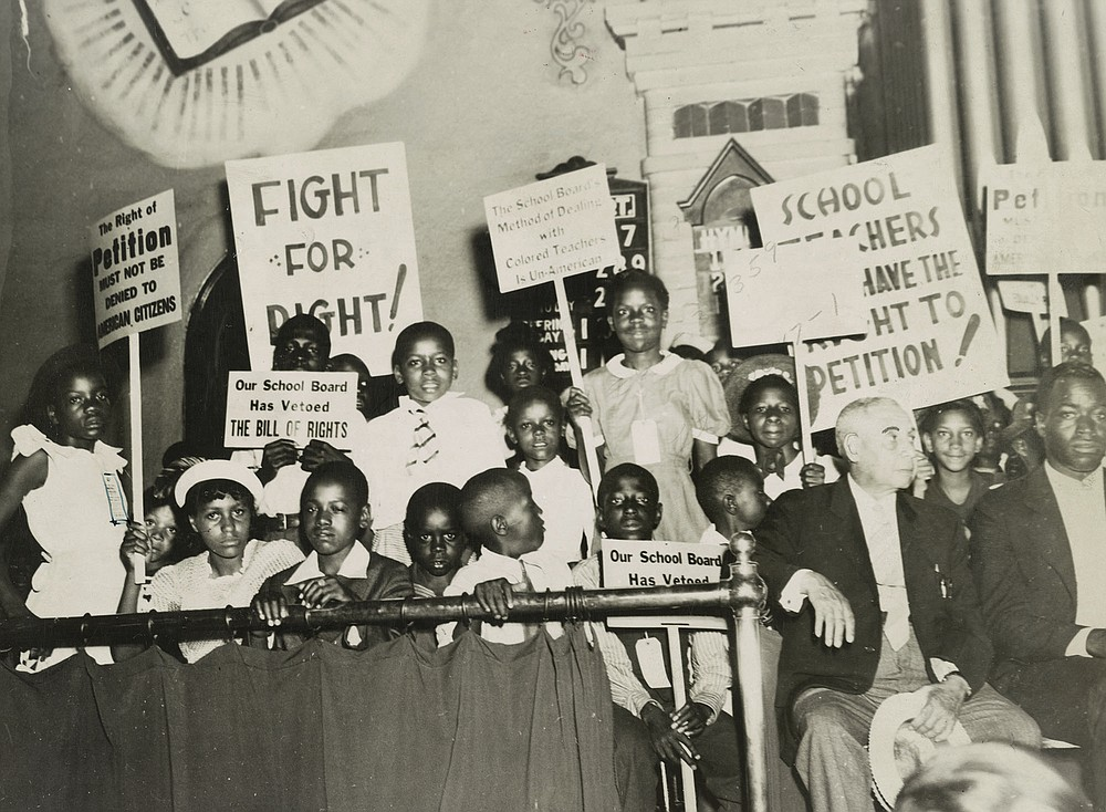 """""""Fighting for the Right to Fight: African American Experiences in WWII,"""" on display starting Tuesday Jan. 19 at the University of Arkansas-Pulaski Technical College, includes images of school children protesting treatment of Black teachers in Norfolk, Va., June 1939. (Special to the Democrat-Gazette/courtesy Library of Congress)"""