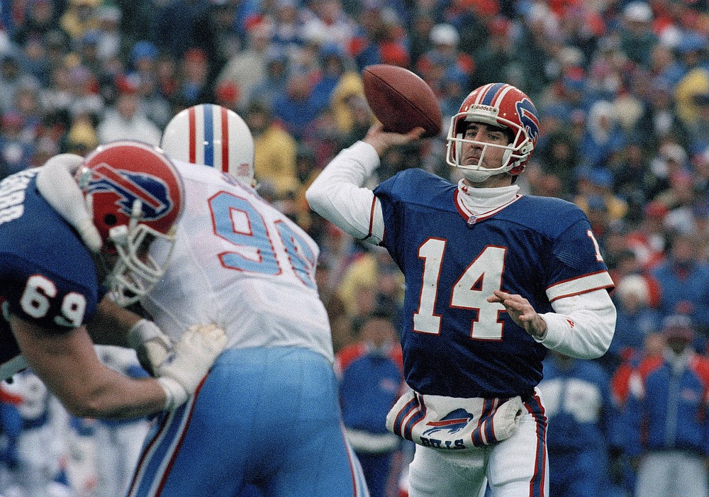FILE - Buffalo Bills quarterback Frank Reich passes against the Houston Oilers in an NFL football game at Rich Stadium in Orchard Park, N.Y., in this Jan. 3, 1993, file photo. Reich rallied the Bills from a 35-3 deficit to a 41-38 win in overtime. Indianapolis Colts head coach Frank Reich returns to Orchard Park for an NFL wild-card football game against the Bills on Saturday, Jan. 9, 2021. (AP Photo/John Hickey, File)