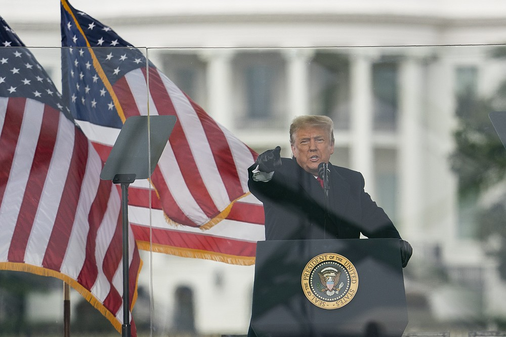 President Donald Trump addresses supporters, with the White House in the background, on Jan 6.