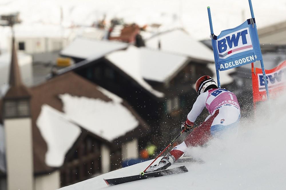 Switzerland's Loic Meillard speeds down the course during an alpine ski, men's World Cup Giant slalom, in Adelboden, Switzerland, Saturday, Jan. 9, 2021. (AP Photo/Gabriele Facciotti)